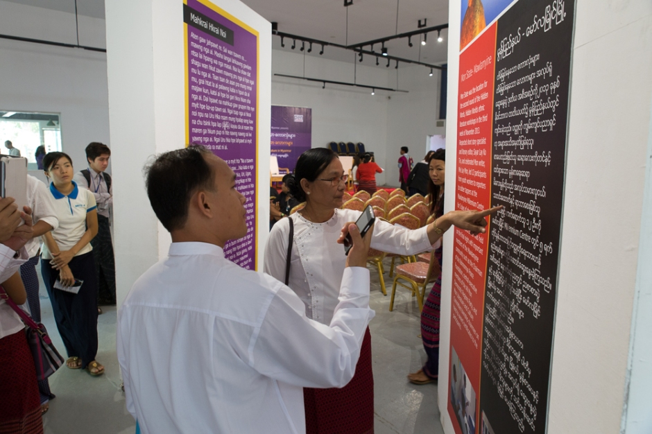 Ethnic Mon writers Min Min Khaing and Mie Lay Mon reading short story gallery boards