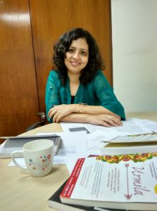 Pervin at the editing desk with Urmila