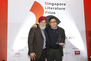 Kitaab's poetry editor Desmond Kon receiving his prize from Professor Kirpal Singh