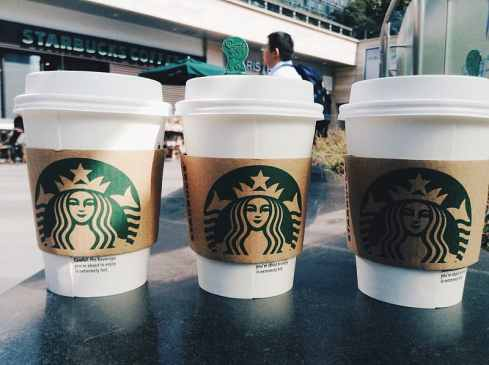 three-white-starbucks-coffee-cups